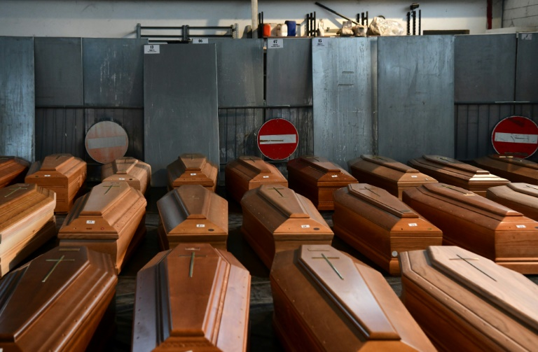 Italy's Italy's Dead Overwhelm Morgues As Virus Toll Tops 8,000