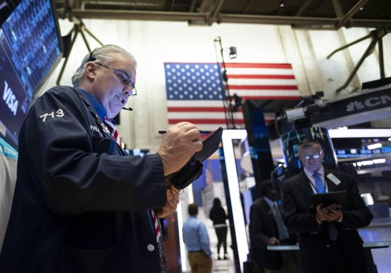 Late Surge Lifts Wall Street Stocks Admist Virus Attacks