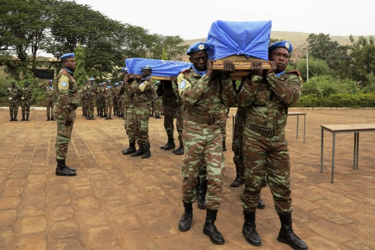 Malian and MINUSMA soldiers carry flag-draped coffins of U.N. soldiers during funeral in Bamako